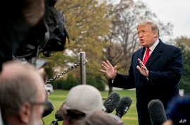 President Donald Trump speaks to members of the media before boarding Marine One on the South Lawn of the White House in Washington, Nov. 26, 2018.