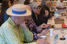 Steven Margolis (center) at at Zabar's delicatessen in New