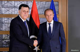 Libyan Prime Minister Fayez al-Sarraj poses with European Council President Donald Tusk in Brussels, Belgium, May 13, 2019.