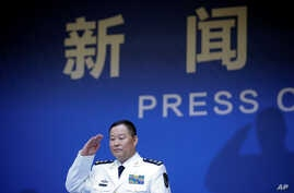 Qiu Yanpeng, deputy commander of the People's Liberation Army (PLA) Navy, arrives at a news conference ahead of the 70th anniversary of the founding of Chinese People's Liberation Army Navy, in Qingdao, China, April 20, 2019.