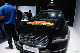 FILE - A Lincoln car with self-driving equipment developed by Ford and Baidu is seen at a product launching event in Shanghai, China, April 3, 2019.