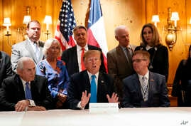 President Donald Trump speaks with reporters about border policy during a fundraising event, April 10, 2019, in San Antonio, Texas.