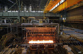 FILE - In this photo taken May 31, 2012, a furnace of the Mobarakeh Steel Complex is seen, 280 miles (460 kilometers) south of Tehran.
