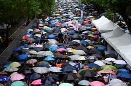 Gay rights supporters wait for the results under the rain outside Parliament while lawmakers discuss the same-sex marriage bill in Taipei, May 17, 2019.