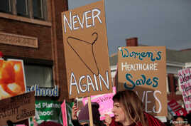 FILE - Supporters of Planned Parenthood rally outside a Planned Parenthood clinic in Detroit, Michigan, Feb. 11, 2017.