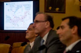 A map of the Arctic Ocean is displayed as officials from the Office of National Intelligence and the Pentagon apppear before a House Intelligence Committee hearing on national security implications of climate change on Capitol Hill in Washington, June 5,