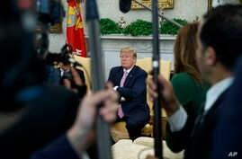 President Donald Trump pauses as he speaks during a meeting with Egyptian President Abdel Fattah el-Sisi in the Oval Office of the White House, April 9, 2019, in Washington.