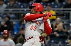 Cincinnati Reds' Yasiel Puig bats in the third inning of a game against the Pirates in Pittsburgh,  April 5, 2019. The former Cuban star has been playing in the major leagues in the United States since 2013.