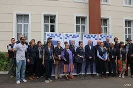 Members of the EU observer mission team pose for a group photo before their deployment Thursday in Blantyre.