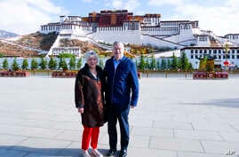 U.S. Ambassador to China Terry Branstad and his wife, Christine, pose in front of the Potala Palace in Lhasa in western China's Tibet Autonomous Region, May 22, 2019