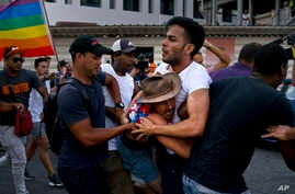Cuban police detain gay rights activists taking part in an unauthorized march in Havana, May 11, 2019. The march was organized largely using Cuba's new mobile internet.