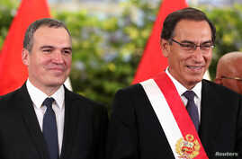 Peru's President Martin Vizcarra and new Prime Minister Salvador del Solar attend a swearing-in ceremony at the government palace in Lima, Peru, March 11, 2019.