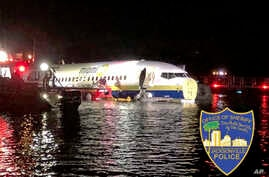 Authorities work at the scene of a plane in the water in Jacksonville, Fla., May 3, 2019. A Naval Air Station Jacksonville news release says a Boeing 737 arriving from Naval Station Guantanamo Bay, Cuba, crashed into the St. Johns River Friday night....