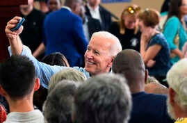 Former Vice President Joe Biden takes photos with supporters following the first rally of his 2020 campaign, May 4, 2019 in Columbia, S.C.