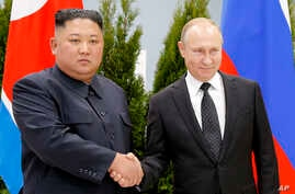 Russian President Vladimir Putin, right, and North Korea's leader Kim Jong Un shake hands during their meeting in Vladivostok, Russia, Thursday, April 25, 2019.