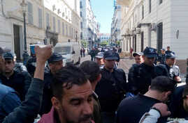 Police block the roads as former Prime Minister Ahmed Ouyahia appears in court in Algiers, Algeria, April 30, 2019.