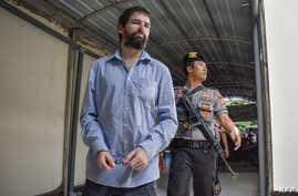 Frenchman Felix Dorfin, left, arrives at a court in Mataram on the resort island of Lombok, May 20, 2019, where an Indonesian court sentenced him to death for drug smuggling, in a surprise verdict after prosecutors asked for a 20-year jail term.