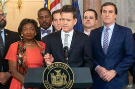 New York State Senator Brad Hoylman, D-Manhattan, center, speaks during a news conference, May 8, 2019, at the Capitol in Albany, N.Y., about a Senate bill to authorize the release of individual New York state tax returns to Congress.