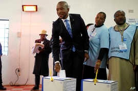 Democratic Alliance leader Mmusi Maimane casts his vote Wednesday, May 8, 2019 in general elections in Soweto, South Africa.