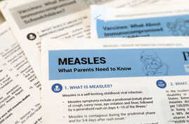 FILE PHOTO: Materials are seen left at demonstration by people opposed to childhood vaccination after officials in Rockland County, a New York City suburb, banned children not vaccinated against measles from public spaces.