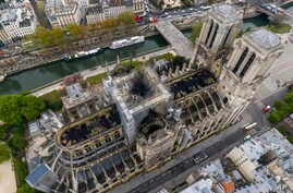 An image made available by Gigarama.ru on Wednesday April 17, 2019 shows an aerial shot of the fire damage to Notre Dame cathedral in Paris on Tuesday April 16.