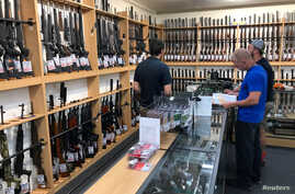 FILE - Firearms and accessories are on display at Gun City gunshop in Christchurch, New Zealand, March 19, 2019. New Zealand toughened its gun laws after a mass shooting at two mosques in Christchurch.