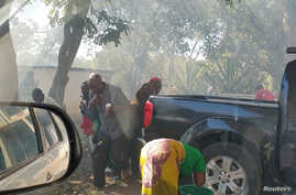 People react to tear gas outside the Malawi Congress Party headquarters in Lilongwe, Malawi, June 6, 2019, in this still image obtained from video taken from social media. Ulemu Msungama (Malawi Congress Party)/via REUTERS. REUTERS THIS IMAGE HAS BEEN SUPPLIED BY A THIRD PARTY. MANDATORY CREDIT. NO RESALES. NO ARCHIVES. - RC1A25F0E350