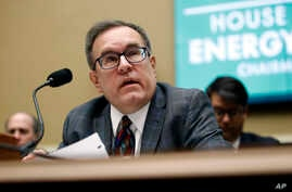 FILE - Environmental Protection Agency Administrator Andrew Wheeler testifies before the House Environment and Climate Change Subcommittee on Capitol Hill, April 9, 2019.