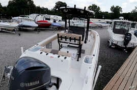 FILE - New boats are on display at a marine dealership in Chester, Va., July 11, 2018. Some U.S. manufacturers are feeling the impact of tariffs that the Trump administration has imposed on products from China, Europe, Mexico, Canada, India and Russi...