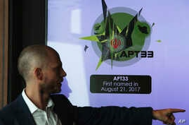 Alister Shepherd, the director of a subsidiary of the cybersecurity firm FireEye, gestures during a presentation in Dubai, United Arab Emirates, Sept. 18, 2018.