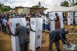 People cast their votes at a polling station in Mzuzu, Malawi during general elections on May 21, 2019.
