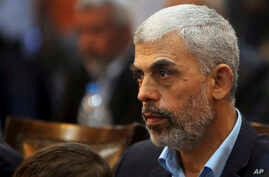FILE - Hamas leader Yehiyeh Sinwar in Gaza attends a news conference in Gaza City.