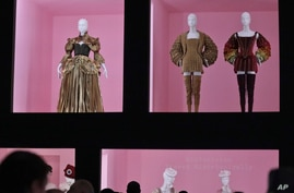 """Fashion designs for the Metropolitan Museum of Art's Costume Institute gala exhibit, """"Camp: Notes on Fashion,"""" is unveiled at a press preview, May 6, 2019, in New York."""