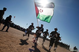 FILE - Polisario Front soldiers take part in a parade for the 35th anniversary celebrations of their independence movement for Western Sahara from Morocco, in Tifariti, southwestern Algeria, Feb. 27, 2011.