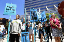 Supporters attend a rally Tuesday, June 4, 2019 for a group of young people who filed a lawsuit saying U.S. energy policies are causing climate change and hurting their future.
