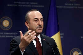 Turkish Foreign Minister Mevlut Cavusoglu speaks to the media during a news conference with Polish Foreign Minister Jacek Czaputowicz and Romanian Foreign Minister Teodor Melescanu following a meeting of political-military consultations between the N...