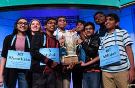 The eight co-champions of the 2019 Scripps National Spelling Bee, from left, Shruthika Padhy, 13, of Cherry Hill, N.J., Erin Howard, 14, of Huntsville, Ala., Rishik Gandhasri, 13, of San Jose, Calif., Christopher Serrao, 13, of Whitehouse Station, N.J., Saketh Sundar, 13, of Clarksville, Md., Sohum Sukhatankar, 13, of Dallas, Texas, Rohan Raja, 13, of Irving, Texas, and Abhijay Kodali, 12, of Flower Mound, Texas, hold the trophy at the end of the competition in Oxon Hill, Md., Friday, May 31, 2019. (AP Phot