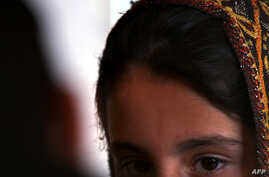 FILE - A young Pakistani girl who escaped a forced marriage speaks to a reporter in the country's northwest.