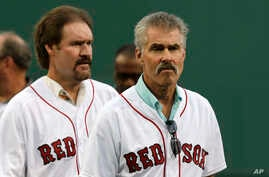 FILE - Former Boston Red Sox's players Bill Buckner, right, and Wade Boggs prior to a baseball game against the Colorado Rockies in Boston, May 25, 2016.