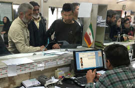Afghan refugees submit documents at the Soleimankhani center for refugees in Tehran, Oct. 24, 2016.