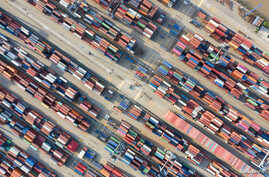 Containers are seen at a port in Ningbo, Zhejiang province, China May 28, 2019. Picture taken May 28, 2019. REUTERS/Stringer ATTENTION EDITORS - THIS IMAGE WAS PROVIDED BY A THIRD PARTY. CHINA OUT.     TPX IMAGES OF THE DAY - RC1945D6D100