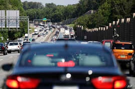 Traffic backs up on Interstate 20 at the beginning of the Memorial Day weekend in Lithonia, Ga., May 26, 2017. As the summer driving season begins, President Trump's tariffs on Mexico could raise gas prices.