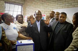 President Cyril Ramaphosa casts his vote at the Hitekani Primary School in Soweto, Johannesburg, South Africa, May 8, 2019.