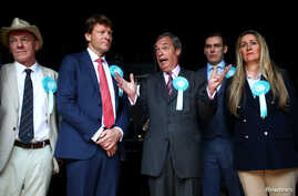 Brexit Party leader Nigel Farage and members of the party attend a Brexit Party campaign event in Essex, Britain, May 16, 2019.