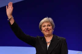 Britain's Prime Minister Theresa May waves after giving her keynote address on the fourth and final day of the Conservative Party Conference 2018 at the International Convention Centre in Birmingham, central England, on October 3, 2018. (Photo by Ben STANSALL / AFP)