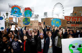 FILE - Demonstrators take part in a protest against climate change, organized by the YouthStrike4Climate movement, in London, March 15, 2019.