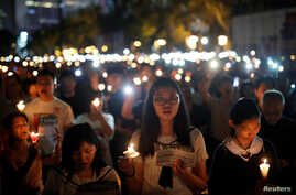 Thousands of people take part in a candlelight vigil to mark the 30th anniversary of the crackdown of pro-democracy movement at Beijing's Tiananmen Square in 1989, at Victoria Park in Hong Kong, China June 4, 2019.