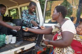 Flood survivors receive medication during mobile clinic hours in Machinga district.