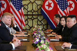 North Korea's leader Kim Jong Un and U.S. President Donald Trump look on during the extended bilateral meeting in the Metropole hotel during the second North Korea-U.S. summit in Hanoi, Vietnam, Feb. 28, 2019.