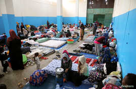 FILE - Migrants are seen at the Anti-Illegal Immigration Agency in al-Nasr detention center in Zawiya, west of Tripoli, Libya, April 26, 2019.